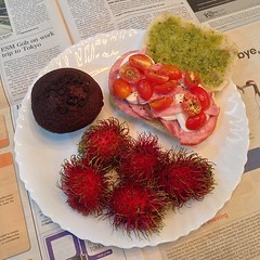 tonight's #dinner is an apple #ham sandwich with #pesto and #bufala #mozzarella, a #chocolate #muffin, and a bunch of #rambutan from thailand! the fruit is from housemate jan!!!