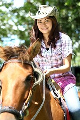 jockey(0.0), animal sports(1.0), equestrianism(1.0), equestrian sport(1.0), halter(1.0), bridle(1.0), horse(1.0), cowboy(1.0),