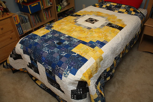 Pixelated minion quilt all ready for being loved