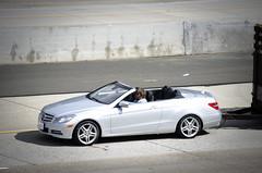 executive car(0.0), family car(0.0), sedan(0.0), automobile(1.0), automotive exterior(1.0), mercedes-benz w212(1.0), wheel(1.0), vehicle(1.0), automotive design(1.0), mercedes-benz(1.0), rim(1.0), bumper(1.0), personal luxury car(1.0), land vehicle(1.0), luxury vehicle(1.0), convertible(1.0),