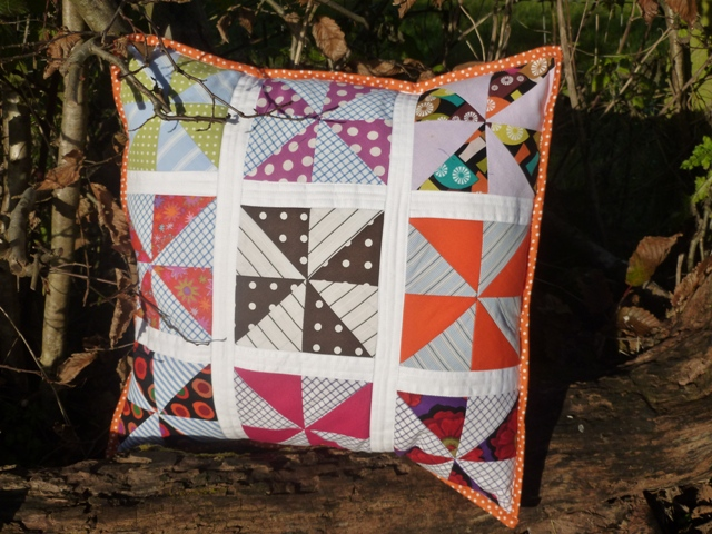 Finished Pinwheels pillow designed by s.o.t.a.k. handmade.
