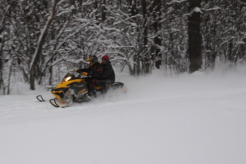 Snowmobile scoots along the railway access track