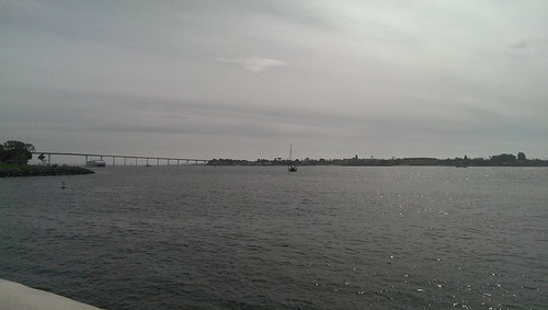 bay with a bridge and land in the distance