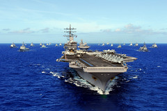 In this file photo, USS Ronald Reagan (CVN 76) transits the Pacific Ocean with ships participating in the RIMPAC 2010 combined task force. (U.S. Navy/MC3 Dylan McCord)