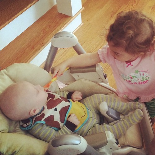 Ava feeding Elijah rice cereal #firstfoods #bigsisterbighelper