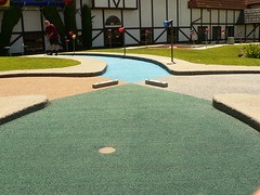 floor(0.0), asphalt(0.0), baseball field(0.0), road surface(0.0), flooring(0.0), sport venue(1.0), grass(1.0), outdoor recreation(1.0), artificial turf(1.0), golf(1.0), miniature golf(1.0), lawn(1.0),