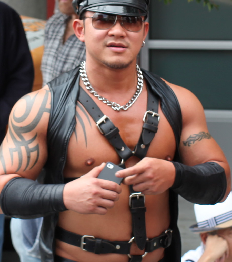 Bare muscle leather play