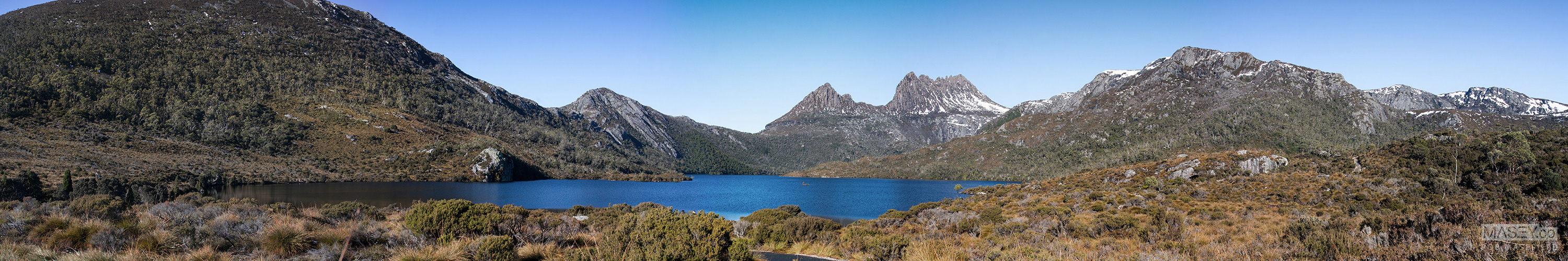 Cradle Mountain rising high under blue skies, above Dove Lake. Magic!