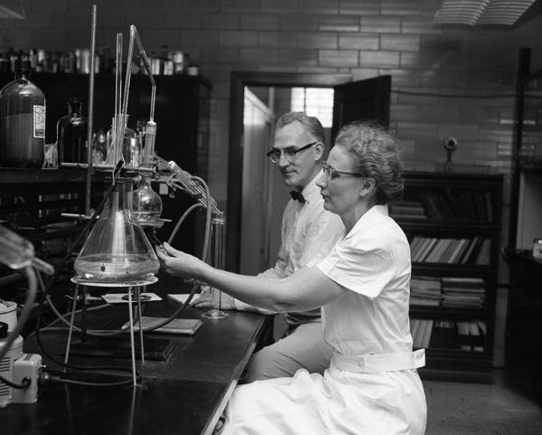 Director John Thompson watching chemist Bertha Munks test food in Tallahassee, Florida