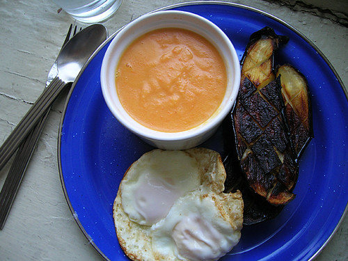 fried eggs, roasted eggplant, and creamed carrot soup