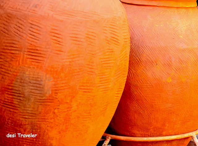 orange earthen pots for water