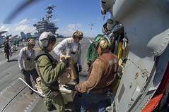 Sailors aboard USS George Washington (CVN 73) load containers of fresh water onto an MH-60S Seahawk from Helicopter Sea Combat Squadron (HSC) 12 for delivery ashore Nov. 15 in support of Operation Damayan. (U.S. Navy photo by Mass Communication Specialist 2nd Class Trevor Welsh)