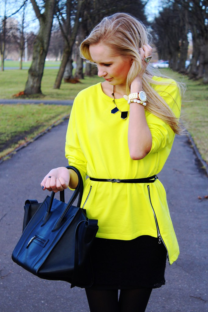 New outfit post on www.callmemaddie.com : in this outfir you can see a side zipper neon color sweater from Persunmall, skull bracelet from Persunmall, mini skirt from H&M, tote handbag celine bag look a like for  a cheaper price