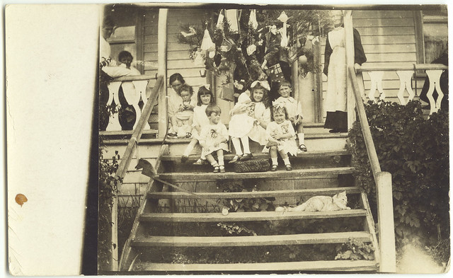 Children beside a Christmas tree (c1910s)