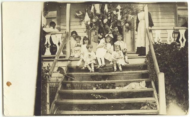 Children beside a Christmas tree (c1910s)