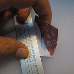 วิธีพับกระดาษรูปหมวกซานต้า 009