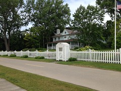 cemetery(0.0), gate(0.0), outdoor structure(1.0), picket fence(1.0), estate(1.0),