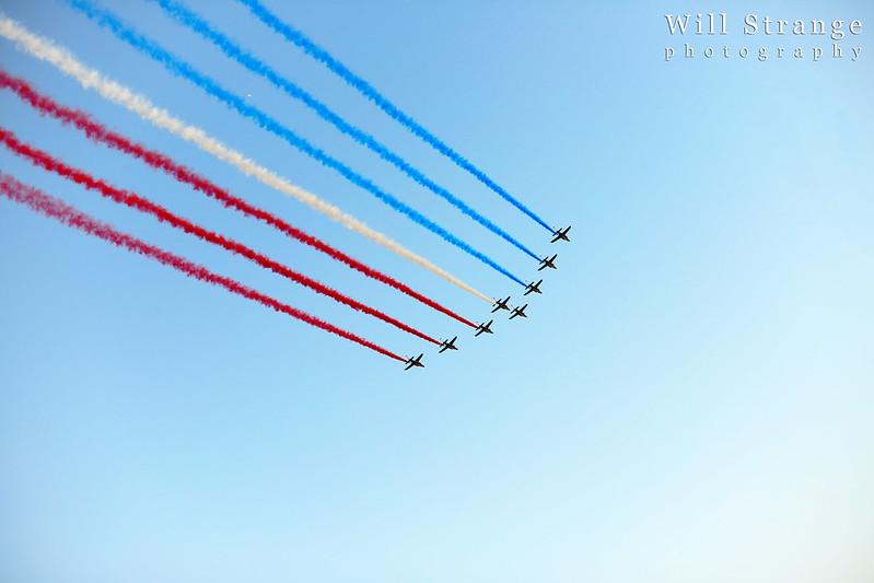 Patrouille de France perform a flypast as the peloton approach the Champs Elysees