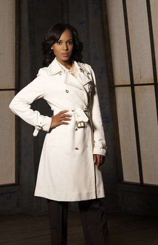 Olivia Pope from Scandal stands in a white pea coat.