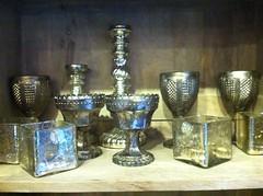 glass bottle(0.0), bottle(0.0), glass(0.0), lighting(0.0), drinkware(1.0), vase(1.0), candle holder(1.0),