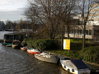 View on the Omval, side of Amstelkwartier along river Amstel; photo is taken from bridge over canal Weespertrekvaart / Spaklerweg - in the sun of December afternoon, Amsterdam city; - urban photography by Fons Heijnsbroek, the Netherlands, 2013