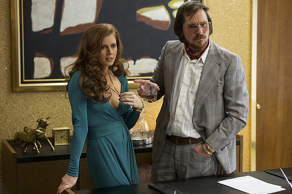 Amy Adams and Christian Bale put one over on everyone in AMERICAN HUSTLE.