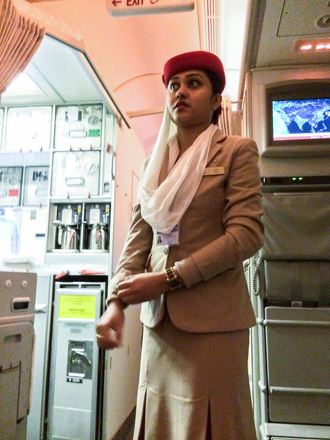 A flight attendant woman wearing beautiful costume in Emirates airline エミレーツ航空のステキな衣装
