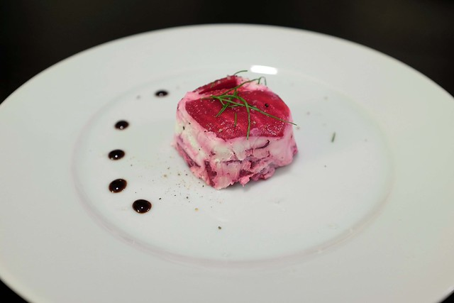 beet & goat cheese terrine, served with balsamic + fleur de sel