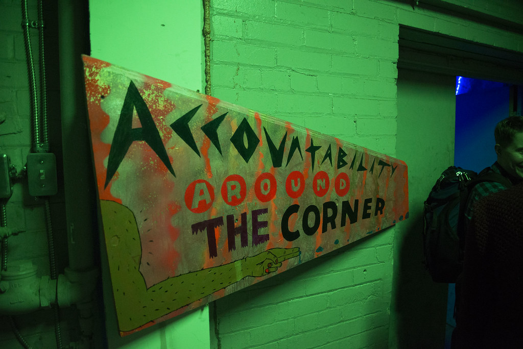 "a day-glo sign says ""accountability around the corner"""