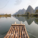 Cruising with bamboo raft on a river, China