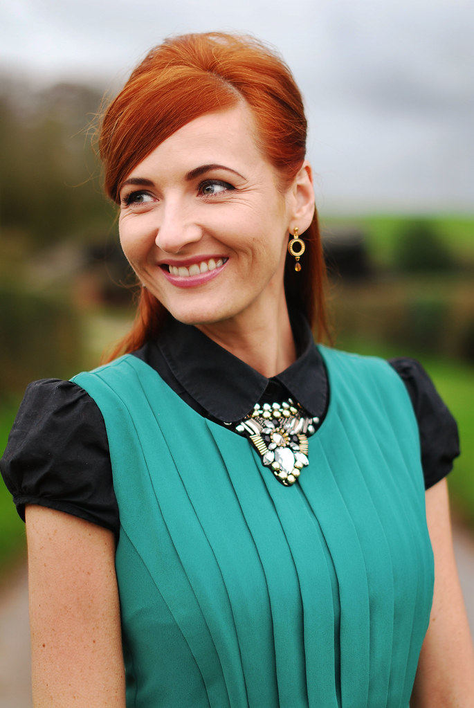Green pleated dress , black shirt & statement necklace