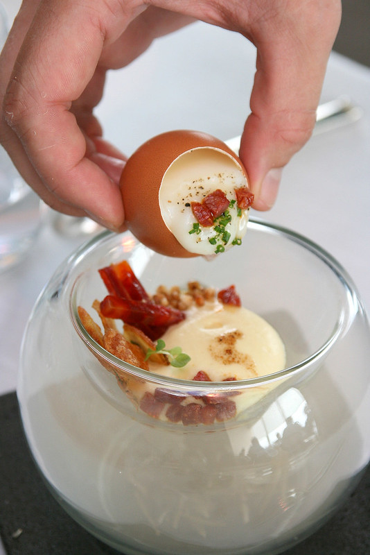 The egg is poured out onto a bed of ratte potato espuma topped with chorizo iberico and buckwheat