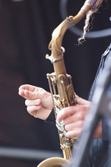 bassist(0.0), string instrument(0.0), baritone saxophone(0.0), guitarist(0.0), guitar(0.0), bass guitar(0.0), reed instrument(1.0), saxophone(1.0), music(1.0), performance(1.0), wind instrument(1.0),