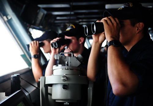 <p>U.S. Navy midshipmen observe surface contacts through binoculars June 10, 2013, aboard the aircraft carrier USS George H.W. Bush (CVN 77) in the Atlantic Ocean. (DoD photo by Mass Communication Specialist 2nd Class Brian Read Castillo, U.S. Navy/Released)</p>