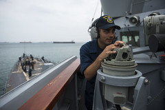 Quartermaster Seaman Ryan Defillipo takes a bearing of a contact as USS McCampbell (DDG 85) enters the Strait of Malacca earlier this week while transiting to India. (U.S. Navy photo by Mass Communication Specialist 3rd Class Paul Kelly)