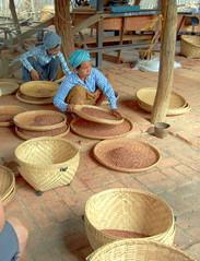 Phawe-Saw villager sifting plum seed powder