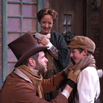 A Christmas Carol, The Musical - Pictured L-R: Cole Burden (Cratchit), Joanie Brosseau-Beyette (Mrs. Cratchit) and Vincent Rodriguez (Tiny Tim) Photo Credit P. Switzer Photography 2013