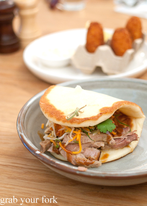 Slow-cooked pork neck narnie with carrot and daikon salad and hoisin dressing