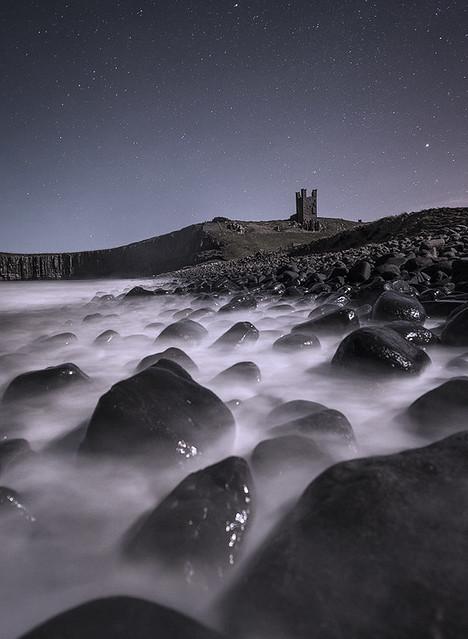Dunstanburgh Castle at night