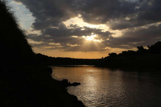Omo River sunrise, sunbeams