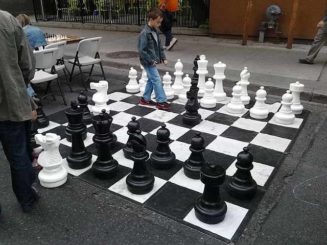 Playing street chess during the Annex Festival on Bloor