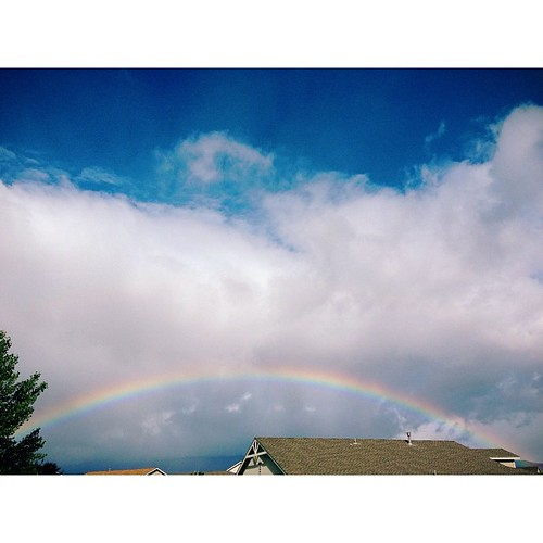 There is the BIGGEST rainbow I have ever seen out there right now. #homemeansnevada #biggestlittlecity #thisisreno