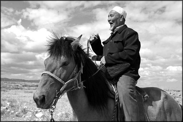 An old Kazakh man on the horseback, Barkol grassland バルクル草原、馬に乗ったカザフの老人