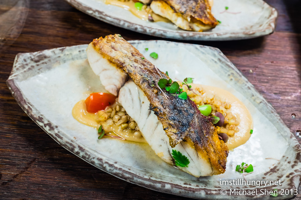 Pan seared ocean barramundi: cone bay ocean barramundi, finished with butter soy on sweet ponzu buckwheat & tomato salsa Sake restaurant