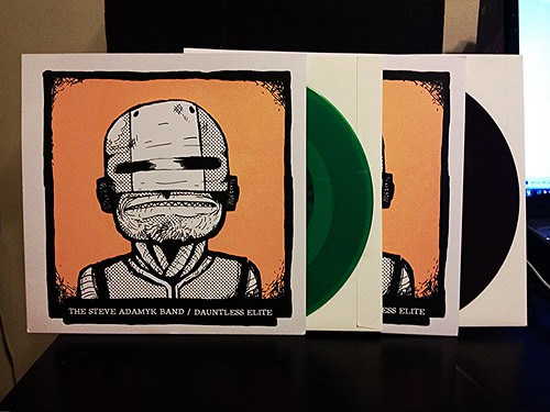 "The Steve Adamyk Band / Dauntless Elite - Split 7"" - Green Vinyl (/100) & Brown Vinyl (/200) by Tim PopKid"