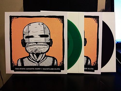 """The Steve Adamyk Band / Dauntless Elite - Split 7"""" - Green Vinyl (/100) & Brown Vinyl (/200) by Tim PopKid"""