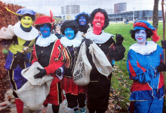 a collection of people dressed in the pete costume with rainbow colored faces