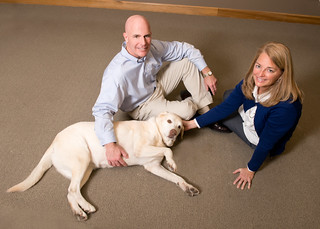 Zville-Storen owners Grey and Kim with their wonderful pet.. by JJ Kaplan
