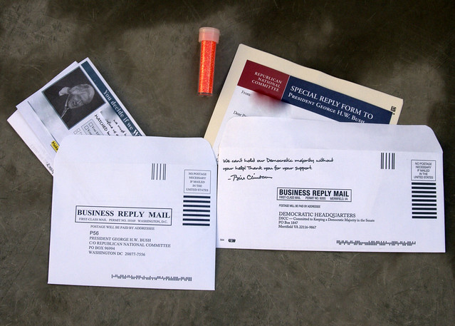 stuffing the envelopes of George W. Bush and Bill Clinton