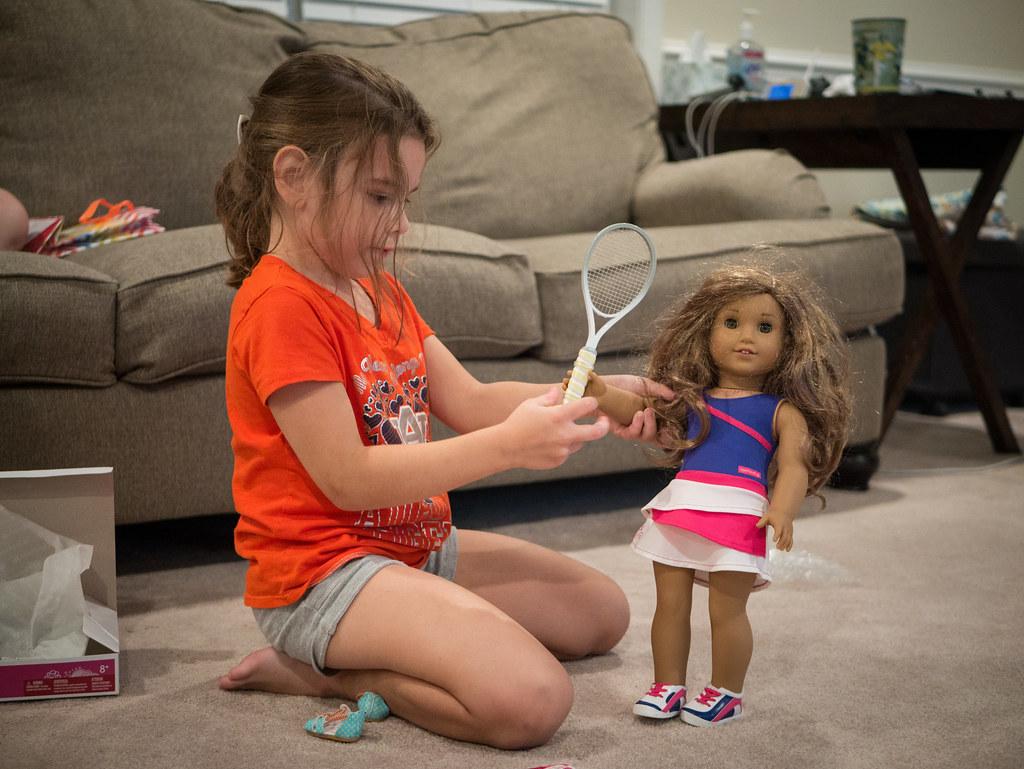 Tennis playing doll